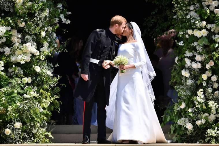 royal-wedding-prince-harry-meghan-markle-fairytale-british-family-windsor-castle-vogue-givenchy-clare-waight-keller-dress-bride-groom-kiss.jpg