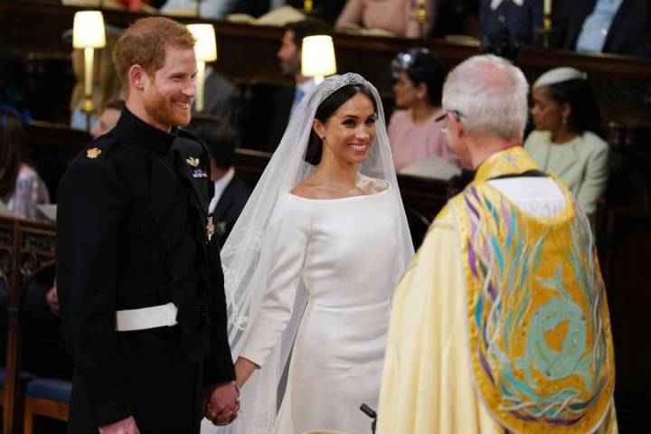 royal-wedding-prince-harry-meghan-markle-fairytale-british-family-windsor-castle-vogue-givenchy-clare-waight-keller-dress-exchanging-vows.jpg