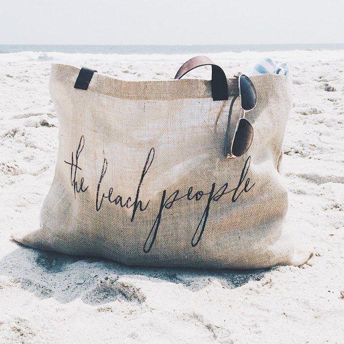 what-do-i-put-beach-bag-essentials-sunscreen-sunglasses-water-book-summer-read-towel-pinterest.jpg